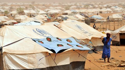 A view of refugees walking at the Mbere refugee camp on May 3, 2012, near Bassiknou, southern Mauritania, 60 km from the border with Mali. The conflict in Mali has caused nearly 150,000 people to flee the country, while about another 230,000 are internally displaced, the UN humanitarian agency said on January 15, 2013. According to OCHA, the UN High Commissioner for Refugees has registered 144,500 refugees in neighbouring countries -- 54,100 in Mauritania, 50,000 in Niger, 38,800 in Burkina Faso and 1,500 in Algeria.AFP PHOTO / ABDELHAK SENNAABDELHAK SENNA/AFP/Getty Images