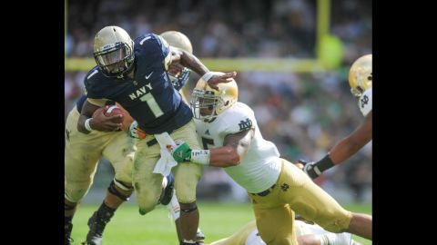 Te'o tackles Trey Miller of Navy during their game in Dublin, Ireland, on September 1, 2012.