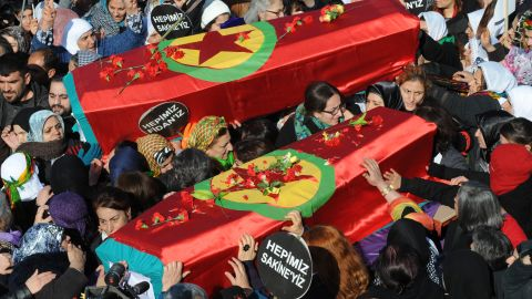 Thousands of Kurds carry the coffins of the three top Kurdish activists Sakine Cansiz, Fidan Dogan and Leyla Soylemez, shot dead in the French capital, on January 17 in Diyarbakir.
