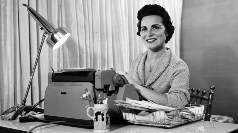 circa 1958: Author and 'Dear Abby' columnist Abigail Van Buren, seated at her desk, her hands on the IBM typewriter. She has counseled several generations of letter-writers seeking advice in a syndicated newspaper column. (Photo by Hulton Archive/Getty Images)