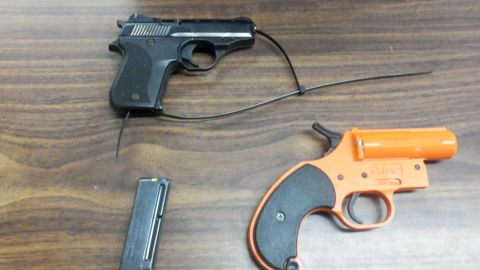 A  7-year-old boy brought a 22-caliber pistol, a loaded magazine and a flare gun to school in his backpack.
