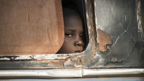 A Malian child looks out from a bus as Malian army soldiers check vehicles and passengers in the city of Niono on Friday, January 18. Malian troops, with help from France and a U.N.-mandated African force, are fighting al Qaeda-linked Islamist militants.