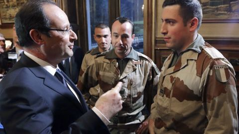 French President Francois Hollande, left, speaks with soldiers who are due to leave for Mali, during a meeting in Tulle, France, on January 19.