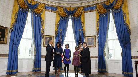 """Obama is known for her loyalty to designers and brands from a variety of price points, often wearing the same items on multiple occasions. At the president's swearing-in ceremony on January 20, 2013, she debuted a dress by Reed Krakoff, whose jackets and gowns she has worn before. Krakoff, the creative director of Coach, started his own label in 2010, <a href=""""http://mrs-o.com/newdata/tag/reed-krakoff"""" target=""""_blank"""" target=""""_blank"""">style blog Mrs. O noted</a>."""