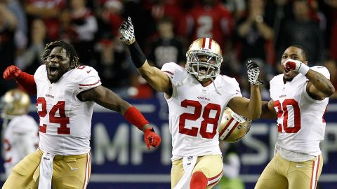 From left, Anthony Dixon, Darcel McBath and Perrish Cox of the San Francisco 49ers celebrate after stopping the Atlanta Falcons on fourth down in the fourth quarter of the NFC Championship Game. The 49ers defeated the Falcons 28-24 at the Georgia Dome in Atlanta on Sunday, January 20.