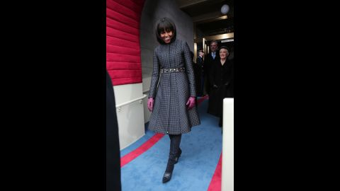 """For Inauguration Day in 2013, the first lady mixed """"high"""" and """"low"""" fashion with a belt from J. Crew, a coat and dress by Thom Browne, Reed Krakoff boots and a necklace by Cathy Waterman, the White House said. After the festivities, the outfit and accessories were to go to the National Archives."""