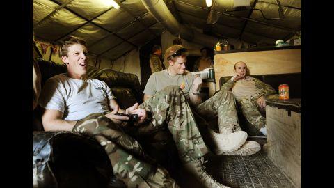 Harry plays video games with fellow pilots Capt. Simon Beattie, left, and Sgt. James John.