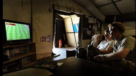 Harry enjoys a break playing video games with Capt. Simon Beattie, left, on November 3, 2012.