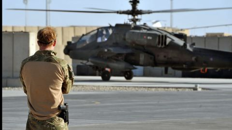 An Apache helicopter, returning from a mission, lands at Camp Bastion as Harry watches on November 3, 2012.