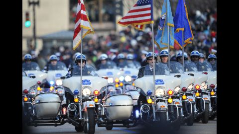 Police take the lead in the inaugural parade January 21 as the first couple walk down a part of Pennsylvania Avenue.