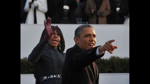 The president and first lady greet crowds as they move along Pennsylvania Avenue on January 21.