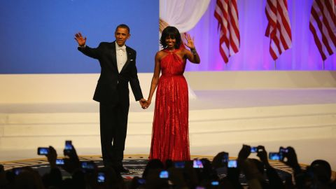 WASHINGTON, DC - JANUARY 21:  U.S. President Barack Obama and first lady Michelle Obama greet the crowd at the Commander-In-Chief's Inaugural Ball January 21, 2013 in Washington, DC. Obama was sworn in today for his second term in a public ceremonial swearing in.  (Photo by Joe Raedle/Getty Images)