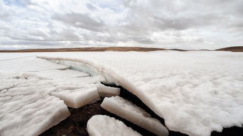 To go with China-Environment-Climate-Rivers by Robert Saiget Ice melts in the source region of China's Yellow River outside of Maduo on the Qinghai-Tibet plateau, known as the 'Roof of the World', on April 19, 2010, in northwestern Qinghai province. Global warming and environmental degradation on the Qinghai-Tibet plateau are cutting into water resources for Asia's mightiest rivers including the Yangtze, Yellow and Mekong, experts say, as melting glaciers and permafrost along the mountain ranges are leading to erosion of the plateau's grasslands and wetlands. AFP PHOTO/Frederic J. BROWN (Photo credit should read FREDERIC J. BROWN/AFP/Getty Images)