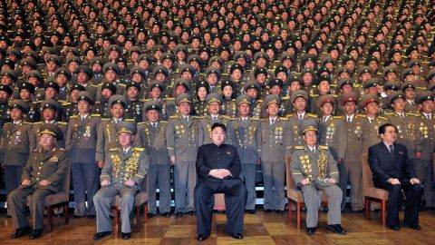 Kim, center, poses in this undated picture released by North Korea's official news agency in November 2012.