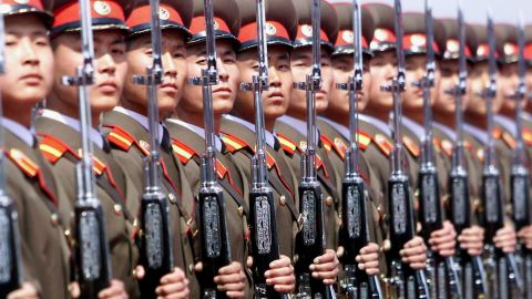 A North Korean military honor guard stands at attention at Pyongyang's airport in May 2001.