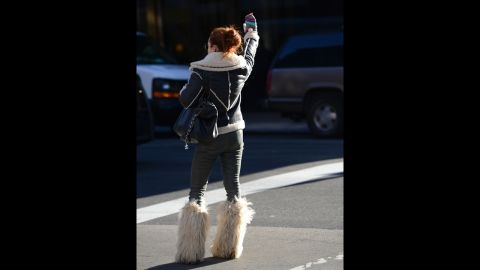A woman hails a taxi on Lexington Avenue on Manhattan's Upper East Side on January 24.