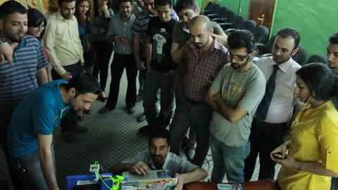 """Bilal Ghalib, an Iraqi-American advocate for hackerspaces in the Middle East, told CNN he wants to see """"A thousand hackerspaces from Turkey to Morocco."""" Here, he demonstrates new equipment to members of Fikra Space, Baghdad's first hackerspace."""