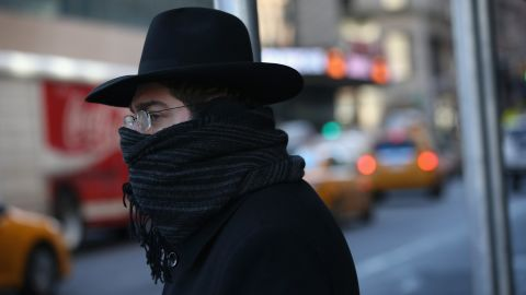 """A pedestrian bundled up against the cold walks through the streets of Manhattan on Friday, January 24, in New York City. Polar air settled in over the northeastern U.S. Wednesday, with temperatures in the teens and 20s. Forecasters warned that """"bitterly cold conditions"""" were expected across much of the Northeast, Mid-Atlantic and Mideast through this weekend."""