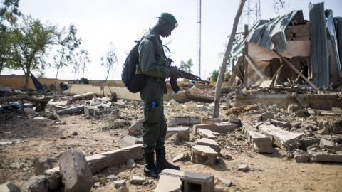 A Malian soldier stands amid debris Saturday, January 26, in the key central town of Konna, which has been under French and Malian army control since last week. It was taken on January 11 by Islamist groups.