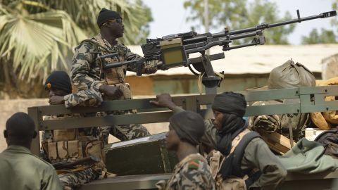 Malian soldiers patrol a street of Diabaly on January 26.