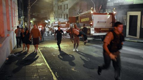A firefighter, center, carries a body after a fire broke out at a disco in Santa Maria, Brazil, on January 27.