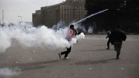 An Egyptian protester throws a live tear gas canister back towards riot police in Tahrir Square on Sunday, January 27 in Cairo, Egypt.