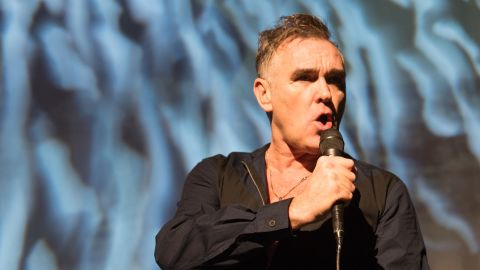 """Fans of singer Morrissey knew the star had been ill after he canceled some U.S. tour stops, but it appears the performer hae been battling cancer. """"They have scraped cancerous tissues four times already, but whatever,"""" Morrissey <a href=""""http://www.rollingstone.com/music/news/morrissey-hints-at-cancer-scare-if-i-die-then-i-die-20141007"""" target=""""_blank"""" target=""""_blank"""">said in an interview with Spanish-language outlet El Mundo</a> in 2014. """"I am aware that in some of my recent photos I look somewhat unhealthy, but that's what illness can do. I'm not going to worry about that."""""""