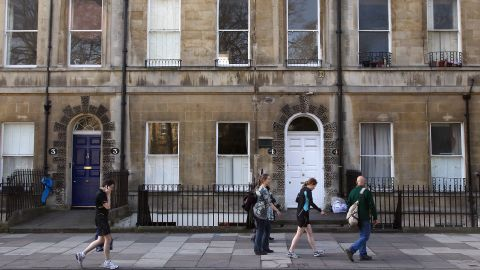 People walk past a house at 4 Sydney Place, Bath, once occupied by the novelist Jane Austen and her family.