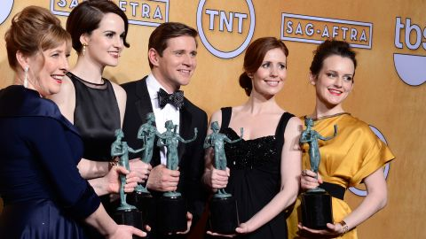 (L-R) Actors Phyllis Logan, Michelle Dockery, Allen Leech, Amy Nuttall and Sophie McShera, winners of Outstanding Performance by an Ensemble in a Drama Series for 'Downton Abbey,' pose in the press room during the 19th Annual Screen Actors Guild Awards held at The Shrine Auditorium on January 27, 2013 in Los Angeles, California.