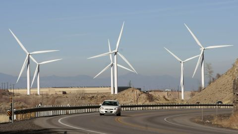 SPANISH FORK, UT - NOVEMBER 24: A car makes it's way up U.S. Highway 6 as several 2.1 mega watt wind powered turbines owned by Edison Mission Energy, sit a the mouth of Spanish Fork Canyon November 24, 2008 in Spanish Fork, Utah. Each turbine is 300 feet tall, with three 150 foot blades. Deputy Assistant Secretary of Land and Minerals Management at the Department of the Interior, Michael D. Olsen, said the potential for production of wind energy on public lands in the West is 'tremendous,' with the alternative energy source already accounting for the fastest growing energy sector in the U.S. Last year the U.S. saw a 46 percent increase in wind capacity and $9 billion in new investments, he said. (Photo by George Frey/Getty Images)
