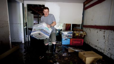 Lindsay Enright starts to clean up the flooded area of his Cullen Street home in Newmarket on January 28.