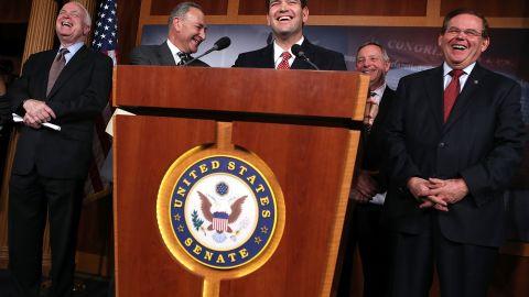 Sen. John McCain (R-AZ), Sen. Charles Schumer (D-NY), Sen. Marco Rubio (R-FL), Senate Majority Whip Sen. Richard Durbin (D-IL), and Sen. Robert Menendez (D-NJ) share a moment during a news conference on a comprehensive immigration reform framework Monday.