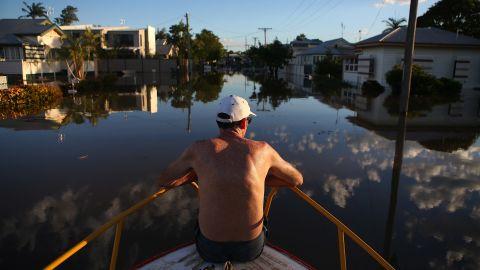 A man checks out flood damage to houses in Bundaberg, Australia, on Tuesday, January 29