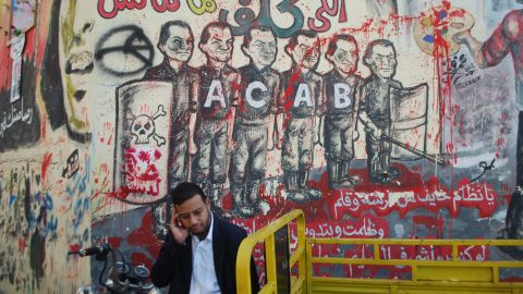 """The Ahlawy played a crucial role in Egypt's two-year-old revolution. Graffiti honoring them and the dead can be seen throughout Egypt. This piece of graffiti next to Tahrir Square shows a line of police, each with the former dictator Hosni Mubarak's face. The acronym ACAB stands for """"All Cops Are Bastards."""""""