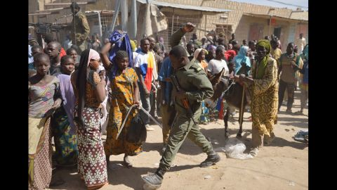 A Malian soldier tries to disperse looters in Timbuktu, Mali, on Tuesday, January 29. Malian and French forces have been battling Islamist militants to loosen their grip on the country. France was the colonial power in Mali until 1960.