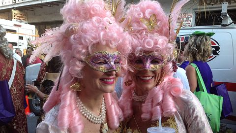 Two ladies from the Krewe of Cork display their Carnival attire during an afternoon parade through the French Quarter.
