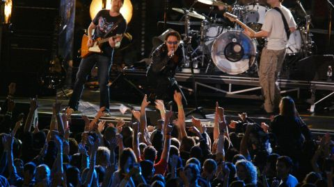 """At the first Super Bowl after September 11, U2 performed a tribute to those lost in the attacks. As the band played """"MLK,"""" the names of victims appeared on a screen. The show ended with a stirring version of """"Where the Streets Have No Name,"""" and Bono revealing the American flag in the lining of his jacket."""