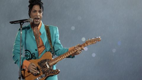 """In addition to his own hits """"Let's Go Crazy,"""" """"1999"""" and """"Purple Rain"""" (in the rain), Prince used the 2007 halftime show to masterfully weave in other artists' classics such as Queen's """"We Will Rock You,"""" Creedence Clearwater Revival's """"Proud Mary"""" and Bob Dylan's """"All Along the Watchtower."""""""