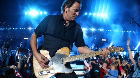 """Bruce Springsteen and the E Street Band took the stage in 2009, the same year he released his 16th studio album, """"Working on a Dream."""" He urged viewers to """"put your chicken fingers down and turn the television set all the way up"""" before launching into hard-rocking hits such as """"Born to Run"""" and """"Tenth Avenue Freeze-Out."""""""