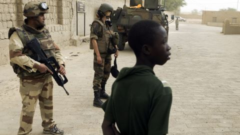 French soldiers patrol next to the Djingareyber mosque, on January 31, in Timbuktu, Mali. The city was recaptured on January 28, by French-led forces in their offensive against Islamist rebels who have been occupying Mali's north since last April.