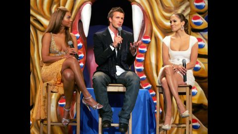 """Beckham poses with Beyonce, left, and Jennifer Lopez in Madrid during a presentation of the new Pepsi """"Samourai"""" in 2004."""