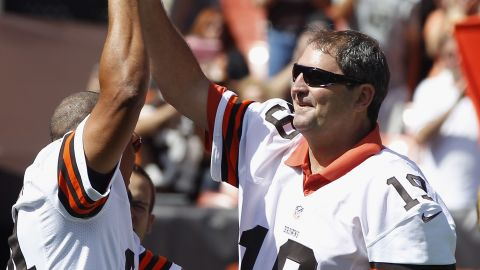 CLEVELAND, OH - SEPTEMBER 09: Former Cleveland Browns players Webster Slaughter #84 and Bernie Kosar #19 are honored before the game against the Philadelphia Eagles their season opener at Cleveland Browns Stadium on September 9, 2012 in Cleveland, Ohio. (Photo by Matt Sullivan/Getty Images