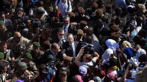 Malians welcome France's President Francois Hollande as he arrives in Timbuktu on Saturday, February 2. French-led troops are working to secure the area against Islamist militants.