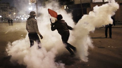 An Egyptian protester throws a tear gas canister toward riot police during clashes outside the Egyptian presidential palace on Friday, February 1, in Cairo. Egypt has been embroiled in violence since last week, the two-year anniversary of an uprising that led to the ouster of then-President Hosni Mubarak.