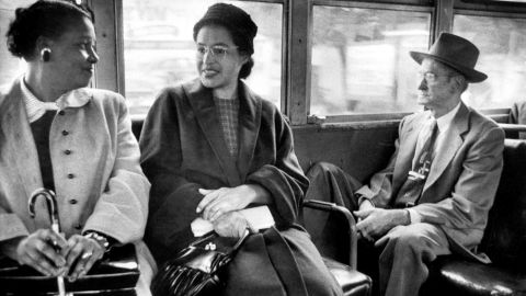 Parks rides on a newly integrated bus in 1956. It wasn't until the 1964 Civil Rights Act that all public accommodations nationwide were desegregated.