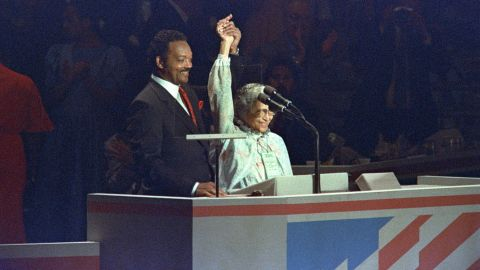 The Rev. Jesse Jackson shows solidarity with Parks at the Democratic National Convention in 1988. Jackson had been a candidate in the Democratic primaries that year.