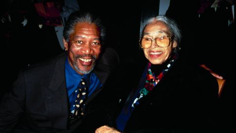"""Actor Morgan Freeman joins Parks at a film premiere party for """"Amistad"""" in 1997."""