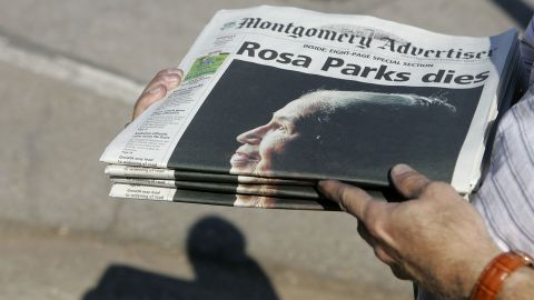 Free copies of The Montgomery Advertiser get handed out before a memorial service for Parks on October 28, 2005. She had died four days earlier at the age of 92.