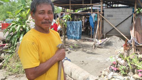 Rodrigo Palaga, 63, says he needs plywood and tools to fix up his battered home. So far, only 20% of families have received any help to carry out emergency repairs on their homes.