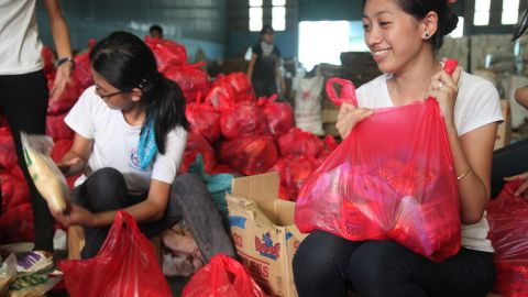 Volunteers help distribute food and non food relief items to affected families.